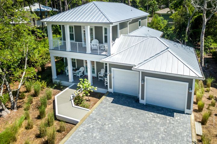 WHAT AN OPPORTUNITY!  Built in 2018, this gorgeous home with designer finishes is located in Dune Allen Beach at the end of Allen Loop, approximately 1/4 mile to the beach access.   This 4-bedroom 3.5 bath, 2 car garage home built by Steve Shires offers open concept living at its best, with living, dining and kitchen providing plenty of space for family and guests.  The current owners made perfect use of space adding a complete butler's pantry with wet bar and Scotsman ice machine.  Some additional extras include, quartz counter tops, designer light fixtures, shaker style soft closed doors/drawers, gas stove, plantation shutters, garage cabinetry, enclosed outdoor shower, tank-less hot water heater, crown molding, recessed lighting, and Galvalume metal roof.   With dual masters, over-sized secondary bedroom and abundant storage this home is perfectly suited as a full-time residence, second home or rental property,.  Outdoor living is at its finest with screened porch, 2 decks, 2 additional porches, and low maintenance Trex-like decking.  The natural landscaping with native plants requires less yard maintenance....this home was designed to enjoy to beach life!  Located on the quiet west end of 30A, close to locally owned shops and restaurants in the town center of Gulf Place.