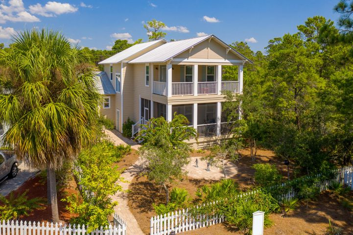 Located in Cassine Village and facing Palmetto Palm Court, this exemplary Greg Goodwin-built custom home emanates classic design, crisp coastal decor, and high-quality construction from the minute you step into the door. Drenched in light and calm neutrals and aquamarines, the generous living and personal spaces offer both comfort and flow. The kitchen is well-appointed with an induction cooktop  and the wire-brushed oak hardwood floors and crisp white shiplap throughout the home are stunning. Two masters provide luxurious sleeping areas for extended family, plus charming guest rooms for the younger set. Carrara marble in the baths and a surround sound system are a plus, while 3 porches offer a shady respite on a hot summer day. Parking is located in rear of home off Lee Place but Cassine Village is out the front door offering 2 tennis courts, 2 pools, and a beautiful cypress forest trail.
