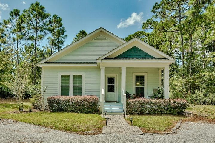 This lovely one-level home welcomes you with a chic paver walkway, nice landscaping and covered porch that is freshly painted.