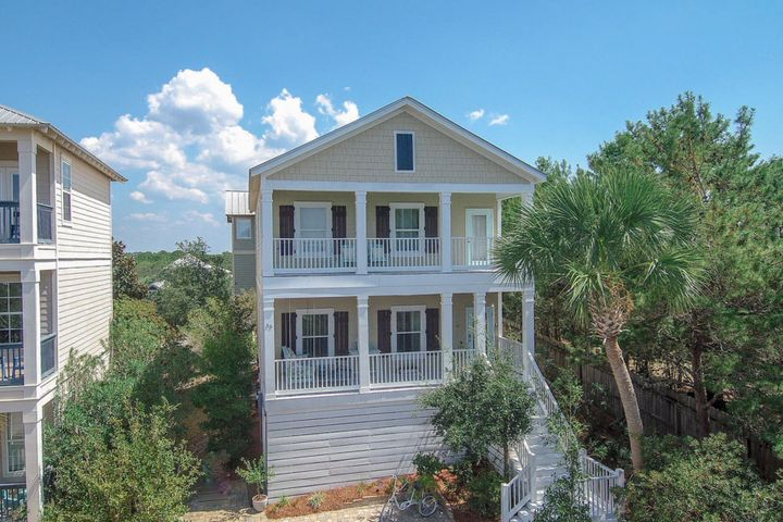 Welcome to Heidi Heights Drive where the elevation allows views of the Gulf and Neighborhood Rooftops.  This precious beach cottage has been well loved and upgraded to add shiplap walls and ceilings, custom paint colors, hand scraped wood flooring, high end lighting, and beautiful furnishings.  This home is truly TURN KEY.   This one owner home is the ideal beach retreat and could be a wonderful full time, second home, or investment property.  The gated community of the Village at Blue Mountain Beach puts you steps to the 83 Beach access and a quick trip to Publix and the local schools.  Bike to Blue Mable, For the Health of It, or Sallys and COMING SOON a new Italian Restaurant right at the entrance of this community Home elevations allows for beach gear, paddle boards, etc to be stored under the home with easy access via a sliding barn door.
