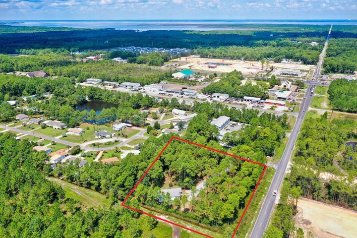 1.94 acres located in South Walton County just off US Hwy 98 on 393 South in 30A with beautiful, lush surroundings and endless opportunities!