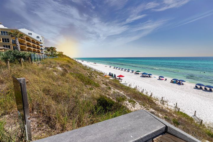 PRICE IMPROVEMENT !!! RARE 4 BEDROOM PLUS BUNK ROOM CONDO  GULF  FRONT AT ADAGIO ON 30A. SPECTACULAR GULF VIEWS AND SUNSETS FROM THIS SPACIOUS 2ND FLOOR 2200 SQ. FT. CONDO WITH OVER SIZED BALCONY. THE OPEN FLOOR PLAN LIVING AREA HAS A GAS FIREPLACE, 10 FT. CEILINGS.CROWN MOLDING, AND A GOURMET KITCHEN.  Kitchen has top of the line Stainless Appliances and granite counter tops. Large Master Suite has Great Views to the Gulf and en suite with double vanities, over sized whirlpool tub, large walk in shower and a Large Walk In Closet. Condo has Travertine Floors in Living Area and Hardwood like Floors in all the Bedrooms. CONDO SOLD FURNISHED ALONG WITH COVERED PARKING & STORAGE. This Condo is a Great Primary or 2ND Home, or Vacation Rental Property.  Great Rental Potential. MUST SEE PROPERTY
