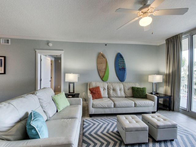 Sprawling living area has comfortable and classy off white leather sofa bed and loveseat. Perfect for the beach.