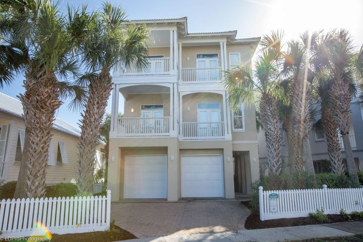 SEASCAPE is aptly named overlooking Lake Caroline and its proximity to the beach. private pool and hot tub too!  Enjoy the views from 4 Balconies that span the front and rear of the home.  Kitchen, dining & living areas open to one another.  4 Bedrooms and 4.5 Baths & a Sitting Area/Study/Office or 5th Bedroom.  Pretty Granite counter tops in the Kitchen & all baths.  Plantation shutters in every window afford light from every direction throughout the home. Pretty Wood flooring in the main living areas with tile in all baths.  Ceilings are 10 feet.  Ceiling fans each bedroom & Living Area.  Screened Porch & Covered Patio. Two (2) Garage areas with plenty of extra room in the garage. Large storage room in the garage & areas in the home used as Owner's Storage.  Great pictures coming soon!