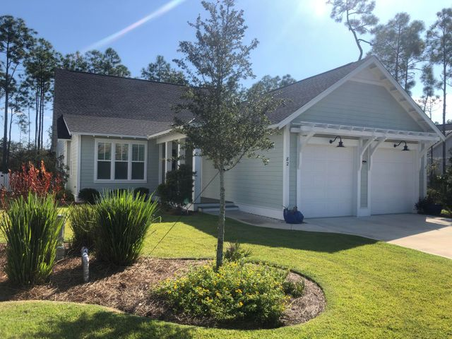Rare 4br, 3bth opportunity in the PATHWAYS section of Watersound Origins. Meticulously kept, this home is only 18 months old  w/minimal usage (Seller's 2nd home).  Large Screen porch is fabulous & home is accentuated w/upgraded hardwood floors throughout, other upgrades include: Quartz countertops, 10'ft ceilings in Main areas & Master bdrm, Gas range, Vented hood, Plantation Shutters, Custom Closets, Custom Fencing & so much more.  As a BONUS, this wonderful home is located on a premium pie-shaped lot mostly surrounded by dense vegetation giving more natural privacy than most! This is truly a turn-key opportunity on one of the best lots and just steps from all the beautiful amenities that Origins offers. Zero-entry Pool, Exercise room, Golf & Tennis are all included in the low HOA fee.