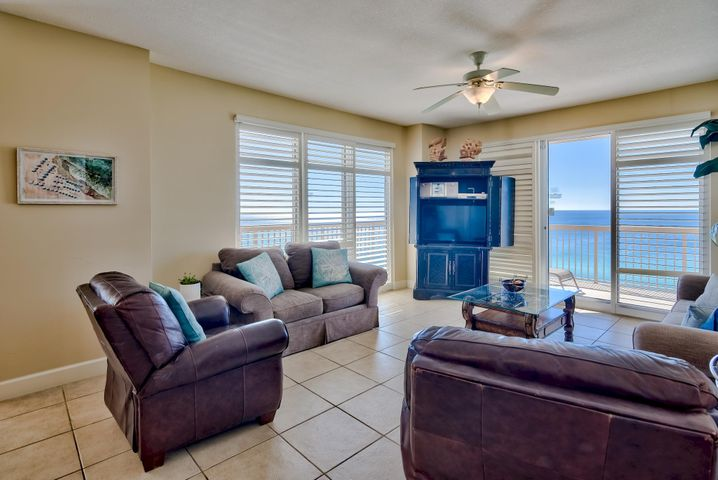 Phenomenal opportunity to own a 3-bedroom, 3-bath East end corner unit. Corner units rarely come on the market and this will not last long! Large windows and doors surround the unit bringing in great natural light and stunning views of the Gulf of Mexico. The spacious wrap-around balcony can be accessed from the living area or master bedroom and is the perfect place to relax, entertain and enjoy outdoor dining. Enjoy views of the Gulf of Mexico, shimmering white sand beaches and the expansive pool area. Exquisite details and features abound in this breathtaking unit. Interior details include an open floor plan, custom plantation shutters throughout, beautiful tile floors and stylish decor. This luxury unit is being sold fully furnished and decorated and is a prime turn key investment! There is a great formal dining area with views of the Gulf and an open kitchen with granite countertops, tile floors, and ample cabinets. The wrap-around granite breakfast bar is perfect for casual dining. The Gulf front master bedroom is separate from the other two bedrooms for added privacy. The master is very spacious with direct balcony access, custom plantation shutters, walk-in closet and en-suite bathroom. Enjoy your morning cup of coffee on the balcony while taking in the views. The en-suite master bath offers tile floors, double vanity, soaking tub to unwind in and a separate walk-in shower. There are two guest bedrooms - one with Gulf views and an en-suite bathroom and the additional guest bedroom has a separate bath nearby. There is a laundry room with a full size washer and dryer and extra storage. This unit is currently on a vacation rental program and has grossed $25.6k year-to-date but could do more as projected revenue is $40k.   Sunrise Beach has luxurious amenities including: 2 elevated Gulf front pools, one heated seasonally, 2 spas, large sun deck, spray park, owners lounge with full kitchen, Gulf front exercise room, theater, plenty of underground parking, Gulf front gas grills, 330 ft. of beautiful white sandy beachfront. An onsite seasonal beach service is available that rents beach chairs and umbrellas and a variety of watersports including jet skis, catamarans, paddle boards, banana boat rides and parasailing! Sunrise Beach is a deluxe 25-story Gulf front complex with 275 units. It is located just east of Pier Park (approx. 1 mile) and only a short drive to Frank Brown Recreation Center and Gulf World marine park. Paradise awaits!
