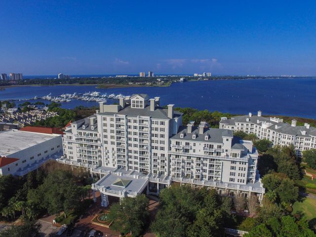 Fantastic Rental income on this 3 Bedroom 3 bath in The Grand Complex! A-rated on Sandestin Rental with breathtaking bay views! You will have the best sunset views from your private, 8th floor, westerly facing balcony. Features include: crown molding, large living & dining areas, wet-bar with titled back splash, porcelain tile throughout the living area, granite counter tops, new Wood look tile floors in bedrooms, hand-carved wood double entrance doors and stainless steel appliances. 2 Master Suites plus and additional full bathroom. The Grand Sandestin is a rental capable luxury condominium featuring Grand Gardens and Fountains, heated Oasis Pool, fitness center, Ballyhoo Bar, gift shop, covered parking, valet service, on-site concierge and check in Sandestin Golf and Beach Resort is a major destination for all seasons and all ages, and has been named the #1 resort on Florida's Emerald Coast. This magical 2,400 acre resort, comprised of over 70 unique neighborhoods of condominiums, villas, town homes, and estates. The resort features more than seven miles of beaches and pristine bay front, four championship golf courses, a world-class tennis center with 15 courts, 19 swimming pools, a 113-slip marina, a fully equipped and professionally staffed fitness center and spa, meeting spaces and The Village of Baytowne Wharf, a charming pedestrian village with events, shopping, dining, family entertainment and nightlife. For true golf cart community living, Grand Boulevard is just outside the resort gates and provides access to additional shopping, dining and entertainment, all without traveling on Hwy. 98.