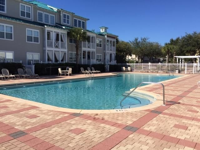 Best deal on 30A! Located in the heart of Blue Mountain Beach and only short walk to the gulf, this beautiful condo is the great investment for primary residence or vacation rental! This ground floor, 3 bed, 2 bath unit has been very well taken care of and comes with new AC unit in 2017, all appliances, dining room table, and couch. The public beach access is about a half mile away and offers restrooms and parking.  The Village at Blue Mountain Beach is a beautifully landscaped, gated community with tons of amenities including, large community pool, workout facility, shuffleboard courts, grilling areas, and golf cart parking/charging area! Don't miss your chance to own a home where beaches are ranked among the best in the world! All info is deemed to be reliable, but is not guaranteed.