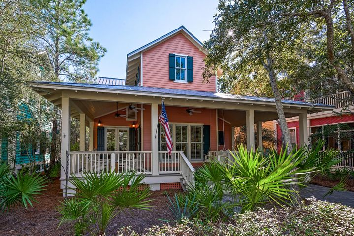 This cozy 3 BR/3BA cottage is within a 5 minute walk to the WaterColor Beach Club, gulf/beach, retail shops and restaurants.  Located on one of the most desireable streets in WaterColor, phase I, this home backs up to Seaside and the trail behind Seaside.  With its vaulted ceilings and open areas, you won't feel closed-in here!  The deep front porch invites you into this updated beach cottage with hardwood floors and udated baths and appliances.  Wonderful floor plan with 2 guest bedrooms on the first floor and Master Bedroom suite on the second.  Large bath wih walk-in closet and beautiful walk-in shower.  Never been on a rental program but a great investment opportunity.  Estimated gross rental at $75K.  Easy to view.