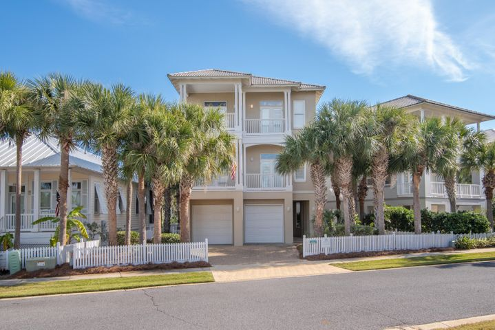 SEASCAPE is aptly named overlooking Lake Caroline and its proximity to the beach. private pool and hot tub too!  Enjoy the views from 4 Balconies that span the front & rear of the home.  Kitchen, dining & living areas all open. 4 Bedrooms , 4.5 Baths & a Sitting Area/Study/Office or 5th Bedroom.  Pretty Granite counter tops in the Kitchen & all baths.  Plantation shutters in every window afford light from all directions throughout the home. Wood floors in the main living areas,  tiled baths. Ceilings are 10 ft. Ceiling fans in each bedroom & Living Area.  Screened Porch & Covered Patio. Two (2) Garage areas with plenty of extra room in the garage. Large storage room in the garage/tool room/Owner's closet.  Measurements to be verified .  Destin Pointe is perfectly located.  Come BUY!