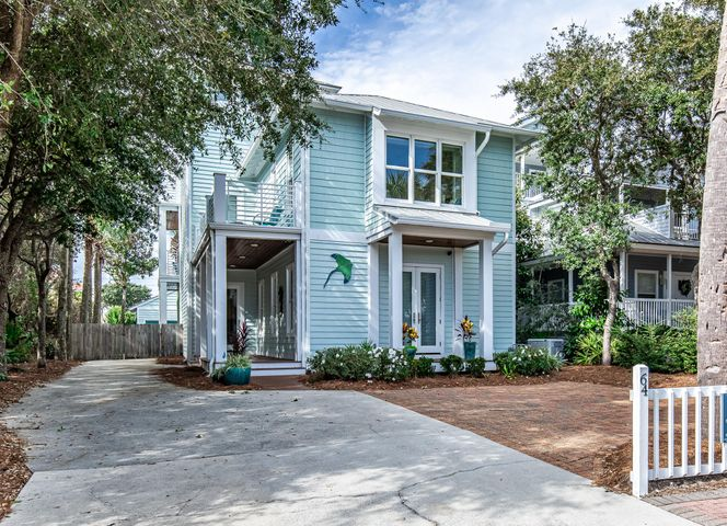 This cozy beach home has been professionally decorated throughout and is located only steps from the beautiful beaches of Destin with deeded beach access. What makes this home so unique is its multi-use capability, with the first story and second story each having its own living room, dining room, full kitchen and 3 bedrooms, making it ideal for a second home, vacation rental or primary home with separate living quarters. The second floor even has its own entrance, so you don't have to access it by going through the first floor. On the third floor there are slight views of the Gulf from the lovely sitting area and private balcony. There are several balconies and patios to enjoy outdoor living and the cool Gulf breeze. Included are two new water heaters (2018), 2 new washer/dryers (2018), a new stove (2019), and a whole house generator that is still under warranty.  A heated pool was installed in 2018 to round out the many amenities of this house.