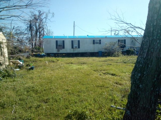 Fixer Upper located on almost 4 acres of land with a large stocked fishing pond - throw your pole out to catch bass, catfish and crappie!  Two mobile homes and large detached garage/workshop - all need work after Hurricane Michael.  1 mobile home is 3/2 and the other is 2/1.  ALL MEASUREMENTS ARE ESTIMATES ONLY.