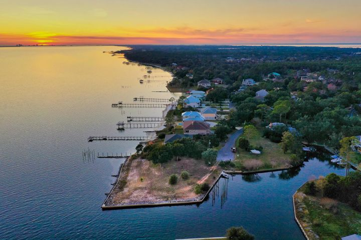 Welcome to the Sanctuary! An incredible, one-of-a-kind residential lot located just off Soundside Drive in Gulf Breeze. This property boasts three quarters of an acre on the water, with over 200 feet on the Sound and plenty of protected waterfront on the canal. This is a boater's paradise! The lot is cleared and ready for your dream home!