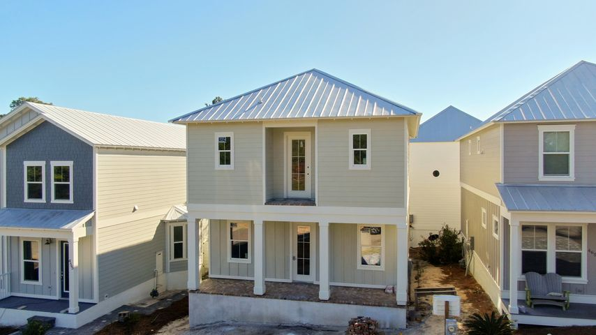 Brand New Construction! Beautiful, coastal beach house situated within walking distance to the beaches of the Gulf of Mexico and the new 30A public beach access.  As you approach the oversized covered front porch, you will notice it is adorned beautifully with ''Old Chicago'' brick in a herringbone pattern. With 10 ft ceilings and huge 8 ft doors on both the first and second level, you will notice that the builder paid attention to all the custom details throughout. This unique, coastal home is designed with 4 bedrooms and 4.5 baths and you will love that each of the four bedrooms has its own bathroom and walk-in closet making it perfect for family or friends visiting or using it as a vacation rental home. There is also a mudroom that is accessible from the outside making it a great place to brush off all the sand from a day at the beach! After returning from the beach, let the kids enjoy the community pool that is only steps away to get the rest of their energy out! Call today to view since this won't last long! More pictures coming upon completion.