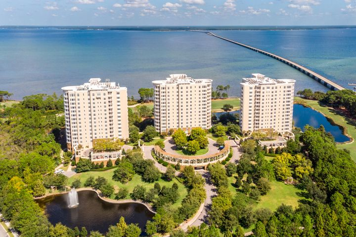TWO ADDITIONAL STORAGE UNITS CONVEY!  Superbly finished residence enjoying sensational views of the Choctawhatchee Bay in Destin, Florida's luxury development known as One Water Place in the sought-after, gated community of Kelly Plantation. This condominium offers one of the most popular floorplans, the Edgewood, which contains 3,008 square feet of functional and luxurious space in which to enjoy a magnificently peaceful and convenient lifestyle! Please note the floorplan that is uploaded to this listing.  The seller has committed beautiful improvements throughout, not the least of which includes gorgeous walnut floors, together with many other fine details, all of which have been impeccably maintained... Ownership of this residence will also include two, rare storage units in the parking garage, one climate-controlled storage unit outside the service entrance to the residence, and two assigned car parking spaces, which are convenient to the respective lobby and semi-private, secured elevator access.                     The plethora of amenities and green-space at One Water Place are world-class, yet access to Kelly Plantation's broad scope of amenities, including tennis and golf, are available to the exclusive ownership of this spectacular community along the Emerald Coast of Florida!      Please inquire to schedule a private showing.