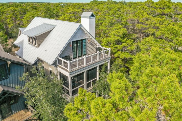 Handsomely designed by Geoff Chick, Draper Lake's renowned Town Architect, this recently built 6 BR home is perched on Observation Tower Park,  boasting expansive Gulf views from its top floor!  Stroll out onto the park with your coffee & your dog from your front porch or mosey down to the boathouse across the park.  Plenty of space for a large family or an empty nester with lots of friends, the carriage house sports a kitchenette and separate bedroom & bathroom. The Main house has five bedrooms, three on 2nd floor, which could be used as an additional sitting room or study.  Under the carriage house is a large two car garage and work area, and storage galore throughout the house designed for a forever home!!!  Draper Lake Coastal Village has two community pools and two boathouses & storing & launching kayaks, canoes or SUP boards.  Hiking trails encircle the entire lakefront of Draper Lake Draper Lake Coastal Village has two community pools and two boathouses for storing & launching kayaks, canoes or SUP boards.  Hiking trails encircle the entire lakefront of Draper Lake &meander throughout the community.  Draper Lake Coastal Village is patterned after an Adirondack resort village with lots of stone   throughout.  All homes have wood exteriors, with this one being cedar.