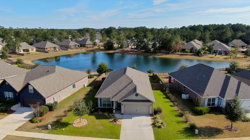 Aerial of house and pond.