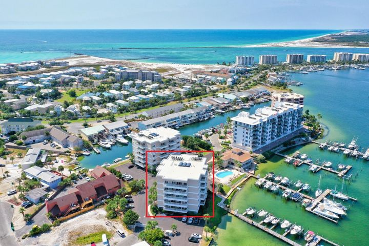 Sun King Towers Unit 2E is a must see harbor front condo! This unit is located in a quiet and secluded setting on the harbor on Holiday Isle. Come home to gorgeous views of the harbor and canal, just moments from the white sand beaches.