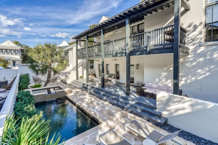 #THECORNEROFUPTOWNANDFUN - is in the center of the ELEGANCE of ROSEMARY BEACH's Main Street & the RACQUET CLUB, Rosemary's INDOOR POOL & the QUIET END OF THE BEACH! This contemporary home was RENOVATED in 2016 & ''white-washed'' throughout, has an EXPANSIVE PRIVATE COURTYARD W/ HEATED POOL & HOT-TUB, OUTSIDE FIREPLACE & STAINLESS GRILLING STATION. A HUGE COVERED PORCH overlooks the courtyard & provides OUTDOOR DINING & LIVING SPACE. MASTER SUITE on 1st floor has SOAKING TUB & shower, Guest room has en-suite bath on 1st floor & laundry LIVING/DINING/KITCHEN on 2nd has 14' CEILINGS & FIREPLACE, HEART PINE FLOORS throughout, SIE-MATIC CABINETS, MARBLE countertops, & THERMIDOR range. LOFT BR makes 3rd BR in main house. 480 sf CARRIAGE HOUSE over 2-car GARAGE w/ EZ straight-in entry. #DONTMISS