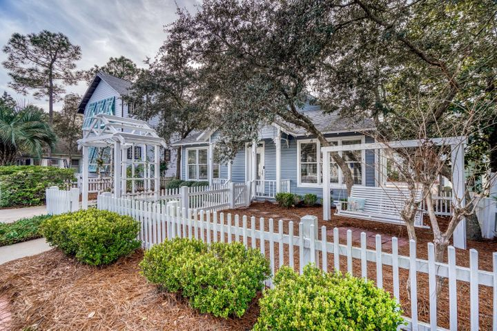This cozy beach cottage is perfectly nestled in the quaint community of Cassine Village. Enjoy the convenience of being close to all the fantastic beach amenities, restaurants and shopping that Seagrove Beach has to offer. The floor plan is very spacious with raised ceilings, making the home feel much larger than you would expect. The first floor has a large kitchen that opens to the dining and living room. There is also a master suite on the floor, as well as one on the second floor. Other great features include ample storage, loft area on second floor and an outside shower to rinse off after a day at the beach. Home has been well cared for and is being sold furnished. Whether you are looking for a vacation rental, second home or primary residence, you will want to see this great property. Cassine Village owners enjoy two refreshing community pools, tennis courts, gorgeous nature trails and an open green area for picnicking, next to the community fishing pond.