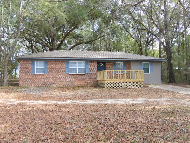 4 Bedrooms, 2 baths, central air/heat, metal roof, new windows on 1 fenced acre
