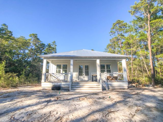 Located in peaceful Grayton Bayou on an interior lot, just a block from the Choctawhatchee bay this gorgeous, 3 bedroom, 2.5 bathroom, new construction home is near completion. This thoughtful design has many notable features including 10'' ceilings, two covered porches, shiplap, shaker style cabinets, walk-in pantry, giant kitchen island with quartz countertops, stainless appliances, tile flooring in the baths and luxury vinyl throughout. The master suite has a humongous tile walk-in master shower with plenty of relaxing room plus bench seat. The exterior of the home features a detached one-car garage, sprinkler system and gravel driveway. The community amenities include pool, neighborhood boat launch, brand new county built public bay park with dock and picnic area. Owners can enjoy ever thing that living in paradise offers being only minutes to the world's most beautiful beaches and convenience to Seaside and Watercolor. Buyer to verify all information.
