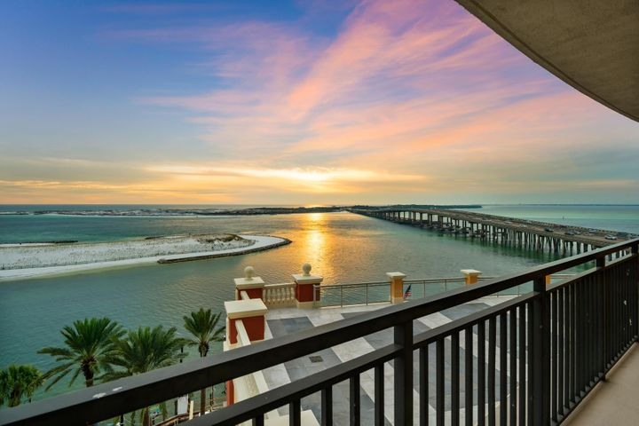 Presiding over an outstanding view of Destin Harbor, and a pleasant stroll from HarborWalk Village, this luxury condo overlooks fishing and pleasure boats coming and going from the harbor. It has the benefit of easy access to the Emerald Grande Spa for beauty treatments and massages, being situated on the same floor. The westerly aspect guarantees stunning sunsets over the water, Destin bridge and harbor. The high-quality accommodations more than match the incredible views. The condo boasts Venetian plaster walls in the principal living areas with hardwood flooring and tasteful new furnishings throughout. The floor to ceiling sliding glass doors in the living area frame the picturesque Gulf view just beyond the spacious wrap-around balcony. The spacious floorplan includes direct access onto the balcony from the living, dining, master suite and guest bedroom. The stylish kitchen features modern raised panel cabinets, attractive granite countertops, and stainless steel appliances. Owner amenities include a pool, fitness center, spa and boat shuttle if you fancy a day at the beach. Head over to Jimmy Buffets Margaritaville as the sun goes down, it's a great venue for watching the weekly fireworks. Excellent waterfront dining is assured at any of the seafood restaurants at HarborWalk Village along with shopping, events and live music. The more adventurous can get out on the calm blue water with kayak rentals, pontoon boats, jet skis, parasailing, fishing charters and dolphin cruises.