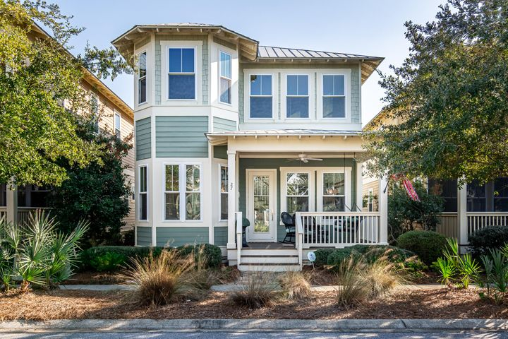 This is one of the best values in NatureWalk. The Beachscape plan offers 2 owner suites, 19' ceilings in the living room, 1 car garage, and is positioned in a complete mature area of NatureWalk, near the front of the neighborhood. The home is finished with real wood floors throughout and Florida cottage style trim wraps all windows and doors. This is a great home for a small family or investment. Just a few doors away, this floorplan is currently producing around $50,000 in gross rental income. NatureWalk has become the go to place near Watercolor and Seaside but off the beaten path for ultimate relaxation. Beach shuttle runs during the summer and will drop you off at local beach accesses and popular destinations on 30A. The Gathering Place is home to 3 pools- one beach entry, a heated lap pool, and kiddie pool. Firepit, grills, and summer kitchen make this a great summer hang out! Come take the trail to the beach- just a 5 minute bike ride!