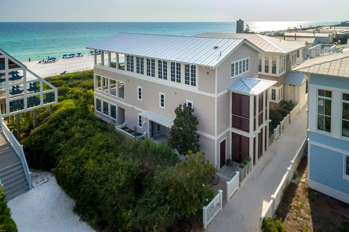 Custom one-of-a-kind and stunning do not come close to describing this Seaside Gulf front home that is truly ''Outside of the Box''. Located on the gulf in Seaside, where New Urbanism was founded, one can enjoy luxury while easily walking to Seaside town center. This beach home offers high-end luxury and has been appreciated by movie stars and prime ministers alike since 2003. Its luxury amenities, include gourmet kitchen, three 20'x 26' gulf front porches, glassed terrace for unobstructed views of the gulf, painted wood plank walls and elevator all define this four bedroom, six and half baths, three story architecturally-acclaimed home. Top of the line finishes include slate floors, stainless steel counter tops, large beamed vaulted ceilings. Exquisitely appointed with a custom-built dining table and an all weather pool table, merely gives one a glimpse into what sets this home apart from its neighbors. The entire first floor is designed for children of all ages. Two bedrooms with four custom built in bunks sleeps eight, four baths, screened porch, all weather pool table and laundry room. The second floor includes two master suites with master baths featuring whirlpool tubs, private balcony, private 20'x 26' porch with gulf views. Third floor boasts a gourmet kitchen the family chef will fall in love with. The entire family can take cooking lessons using family recipes to pass down to generations to come. Island kitchen with seating for five or dine at the custom made table for eight. The finely appointed living room flows onto another 20'x 26' gulf front porch with full view glass panels offering sweeping unobstructed views of the glistening turquoise waters and sugar white sands. Prepare your favorite beverage at the outside bar. A security system, three AC units and hurricane shutters are all mindful components of this home. 2 car carport is deeded with this home.