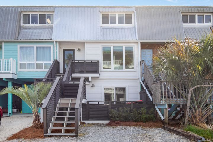 Grayton Beach is quite possibly one of the most eclectic and sought after areas on all of 30a!  Where else can you get a beach permit and drive on the beach!?  This gorgeous townhome is literally a stone's throw away from red bar and the beach.  Recently renovated with new metal roofing, hardie board siding, newly landscaped BACK YARD, all new trex porches, white painted soft close cabinets/drawers, stainless steel appliances, lighting fixtures, granite counters, all bathroom tiling with master rain head shower, square edged cottage trim throughout with tongue and groove accents, engineered hardwood flooring, high impact windows/doors, and plenty more!  This townhome has been meticulously maintained and current owner never short term rented!  Come buy your diamond in the sand!
