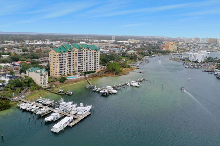 Grand Harbor is Destin's premier residential harbor front community. Situated on the north shore of Destin Harbor, this 4BR/4BA condo has incredible views of the harbor & Gulf of Mexico. You sense the height of the 9.5' ceilings as you walk through the spacious walk-thru kitchen which flows into the grand living room. As you pass the oversized breakfast bar you find a generous gas cooktop, double oven and large pantry. Beyond the sliding glass doors you find an enormous covered balcony. An extremely rare feature, the balcony is plumbed for natural gas to accommodate your outdoor grill.