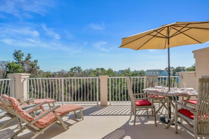 Pride in ownership abounds in this 4 bedroom 4 bathroom, 2248 square foot townhome in the gated community of Coastal Dunes. This property is steps away from Ed Walline beach access, Gulf Place Town Center, Shunk Gulley, Growler Garage and much more. Many features set this townhome apart from the rest.  Gulf views from the roof top terrace!  Formerly the model home, it is an end unit with private outlooks from the additional windows, has only had one owner, and has never been on a rental program.  Coastal Dunes is a secure gated community with only 13 townhomes having access to their community pool. The stargazing from the roof terrace is spectacular at night while you listen to the sound of the waves from the Gulf of Mexico. High end finishes can be found throughout this home including hardwood flooring and natural stone tile bathrooms, custom Levolor blinds, and crown molding throughout.  The kitchen features granite countertops, Samsung refrigerator, Electrolux induction oven, and an Insinkerator water filter/heater. The townhome is being sold fully furnished and features high quality furnishings including living/dining room furniture from La Place, solid teak furniture on the roof top terrace, new king mattresses in 2 ensuite bedrooms and bright new furnishings in ground floor family/bedroom. LG Washer and Dryer. Front door lock easily managed with full internet access paid through 2020.  Currently the only townhome of its kind on the market, this property in Coastal Dunes would make an excellent primary residence, second home, or a wonderful beach investment property. Call today!  All information is deemed reliable but anything important to buyer should be verified.