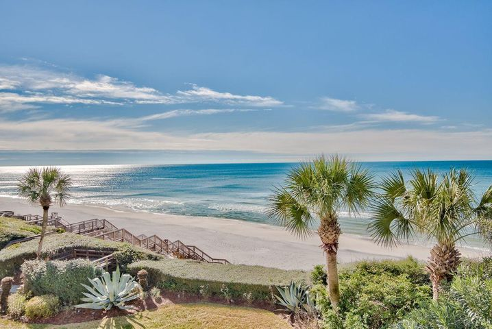 Step into the magical enchantment of living on the Emerald Coast with 180-degree views of the beach and Gulf of Mexico from your private, top floor balcony. The stunning view is unobstructed and promotes harmony and tranquility in a way no other scene can duplicate. This three bedroom, three bath condo awaits new owners who may bring some HGTV ideas to freshen the interior and claim a personal style. The white contemporary kitchen sports marble-look counters, white cottage cabinets, stainless steel appliances, subway tile backsplash and the proverbial window over the sink. Hugging the kitchen is a charming dining nook, and you can see the waters lapping the sugar white sandy beach from both the kitchen and the table. The open living room fronts the water view, and double sets of sliding doors open to a long balcony from which one would never tire of looking between palm trees to the horizon. Look to the left to see the sunrise and angle to the right for the sunset. A white circular staircase rises to the loft bedroom with an ensuite bathroom, and two other bedrooms and bathrooms are here for guests or family members. It's a captivating, low density place to call home or vacation home.