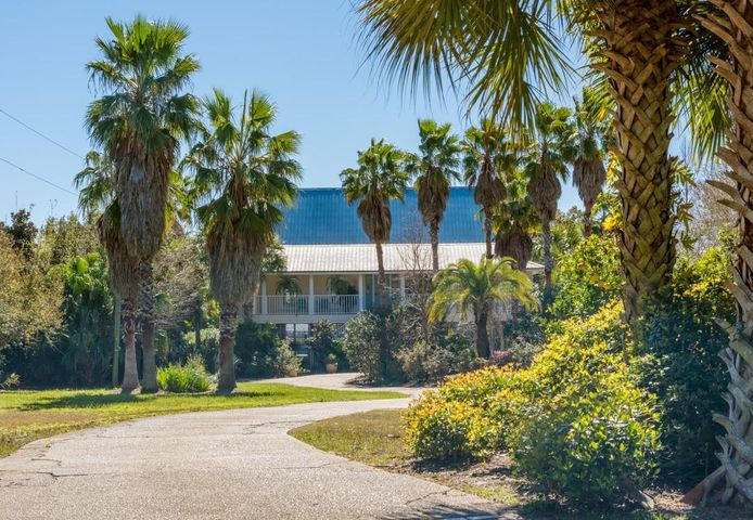 130 feet of waterfront property, (1 acre), located on Santa Rosa Sound approx...halfway between Pensacola Beach and Navarre Beach directly across Santa Rosa Sound from the 16 mile National Seashore Preserve. 2800 sq.ft. Florida Cottage is elevated on pilings with 4 bedrooms and 3 full baths. Open floor plan with vaulted ceilings and view of Santa Rosa Sound. Complete renovation in 2008, including plumbing, electrical, a/c, foam insulation, and metal roof. All ductwork replaced, air handlers cleaned, disinfected, and U/V installed Jan. 2020. Air Quality report available.