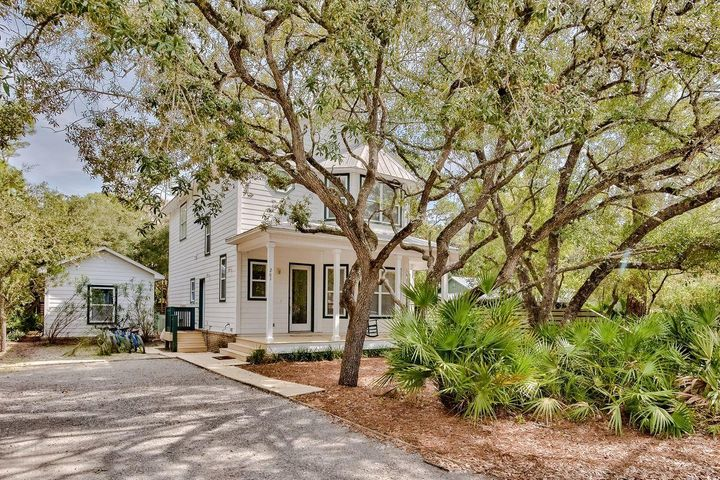 Discover this charming coastal retreat primely positioned in the heart of Grayton Beach situated on a spacious double lot and offering exemplary southern character including a sizable front porch and sprawling mature oak trees all within excellent proximity to the Gulf of Mexico and Western Lake. This property features a four bedroom main house and adjacent guest quarters which is optimally accessible by both Defuniak Street and Grayton Trails Road. The guest suite offers a full bedroom & bathroom and could serve as an owner's quarters, art studio or separate lockout for rental. The main house yields a beautiful open floor plan and has a fun, eclectic style that Grayton Beach is so famously known for.