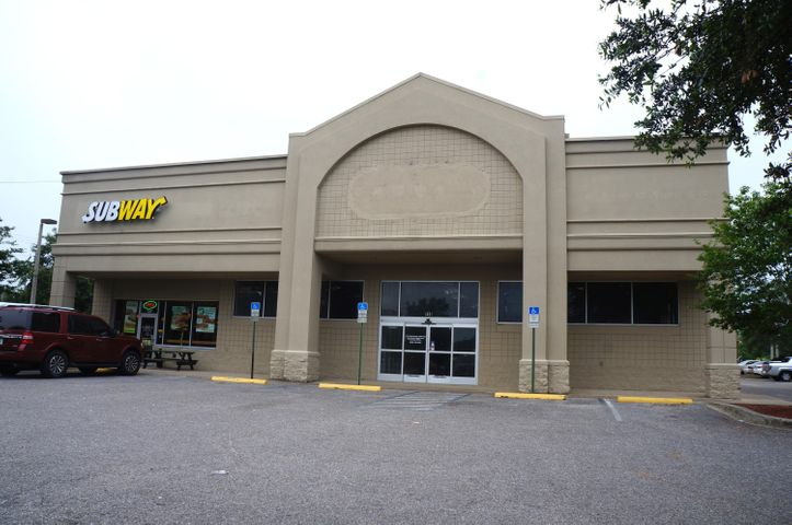 Former CVS freestanding stucco and block building. Subway Sandwich occupies 1,500 SF of this highly visible location. Excellent location with high traffic count and close proximity to the beach exit that is frequently used by tourists and residents. Property is adjacent to Gulf Breeze High School and across from 87,125 SF Publix Anchored Shopping Center.