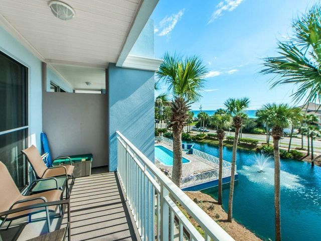 YOUR beach getaway and a superb income producer. Over $32K in 2019. Gulf Place is on the bustling west end of 30A. Located in Gulf Place Cabanas, this 3rd floor corner condo has Gulf Views and overlooks the pool and lake. Lots of natural sunlight and an open den and kitchen concept that flows onto the covered balcony. 1 bedroom/1.5 Bath, Sleeps 6, includes two bunk beds. The bunk alcove is separated off the hallway for addt'l privacy. Gulf Place features a town center with retail, restaurants, 3 pools, & deeded beach access. The large green space amphitheater is the site for year round activities like concerts, car shows, and farmer's markets. Imagine the lifestyle of owning your own personal beach getaway. Offered fully furnished and rental ready.