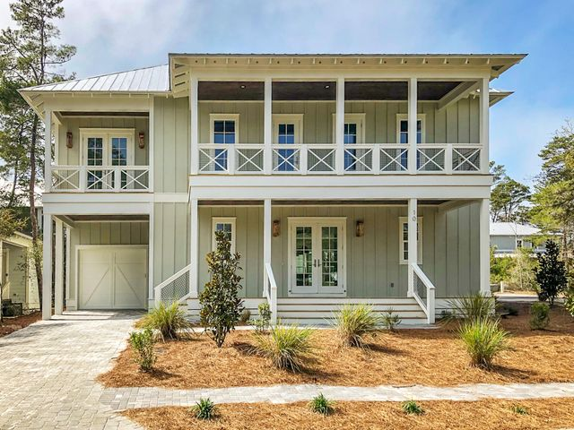 Just completed in time for summer! Located on a corner lot, this gorgeous 4bedroom 4.5 bath home was thoughtfully designed to offer a spacious openconcept plan with two living spaces, expansive windows, double doors andvaulted ceilings. The double porch offers relaxing spaces to dine al frescoor soak up cool morning & evening breezes. A few notable finishes includeshiplap detailing, hardwood flooring throughout, and glam accented kitchenwith quartz countertops and top of the line GE Cafe Appliances - withsmooth, matte white finish and all the latest in cooking advantages! Lakeside at Blue Mountain Beach is an established community with  a neighborhood pooland clubhouse; a shortcut past the pool leads to Redfish Village for nearbydining options and public beach access..... Ideally located between state forest, 30A and the beach approx. 1/2 mile away. More dining and shopping options are just a bike ride away in Blue Mountain Beach.  **Buyer is responsible for personally verifying details about this property. All information contained on the listing is believed to be accurate but not guaranteed. **