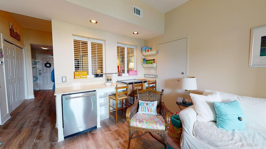 VIRTUAL SHOWINGS ACCEPTED!! Ready to fall in love? Need an escape to the warm gulf coast? Look no further! The owner has spared no expenses in this condo. With 11' tall ceilings, remodeled to include freshly painted, quartz countertops in the kitchen along with Kitchen Aid stainless steel appliances, brand new luxury vinyl plank flooring, remodeled bathroom with travertine flooring, beveled edge subway tile with rain forest shower head,wall mounted sprayer, and frameless shower door. Balcony tiles have been replaced, New HVAC in June of 2018-- condo sleeps 6 people and ready for someone to love it as much as she has! Located a short walk to the community pool,  Ed Walline public beach access, restaurants, & shops.