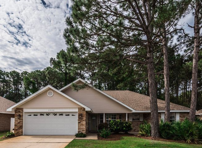 Open floor plan, lots of windows, vaulted ceiling and separate dining room. The back yard deck looks over a heavily wooded area that allows privacy. Great neighborhood in central Destin. Interior laundry room, large two car garage, lawn pump for sprinklers (which are on a timer) so maintenance is easy. All brick exterior with vinyl trim. Brand new roof, new tile and carpet though-out, freshly painted.  Other recent improvements include a remodeled kitchen with granite counter-tops, new gas water-heater, new heat/AC system,  new garage door and door opener, new lawn pump and a picture window in the Great room.This delightful home is move in ready. The Master-suite has wide entry doors to the bedroom and bath.  The step in tub has therapy jets and a great shower. Easy show.