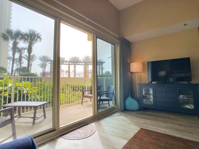 New HVAC Unit replaced March 2020 and has been significantly upgraded/ updated/ restocked Jan 2020. A RARE find, GULF- FRONT, CORNER unit CONDO on the FIRST FLOOR!! NO waiting for the ELEVATORS! The unit has an assigned parking spot. Currently on rental program,2019 rental income $33,778.43 and 2018 rental income $34,451.00 1 bedroom 2 bath with a bunk room. Granite counter tops. Patio overlooks beautiful tropical landscaped lagoon pool. Steps away from the sugar white beaches with a beautiful view of the emerald Gulf!Gated community with 2 outdoor pools a HUGE hot-tub, an indoor, heated pool with a spa, a sauna, two tiki bars and a 24 fitness center. On site check-in desk.