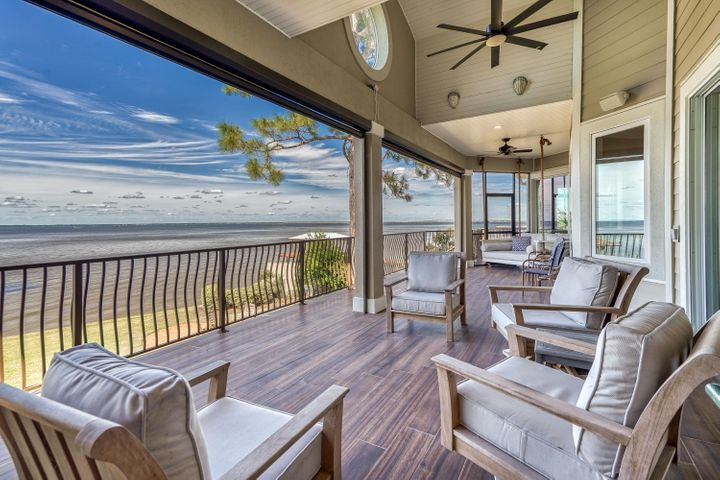 Bay Front Compound 5 mins from 30A beaches.  Right at 1/2 acre w/ 100 waterfront feet directly on Choctawhatchee Bay (Big Water). 8 ft privacy fence surrounds perimeter of the property w/gated entrance to your waterfront oasis. Heated pool, hot tub, pool deck, and outdoor pavilion custom built in 2011 creating a private paradise just minutes from the beautiful South Walton Beaches. 5 bedrooms, 3 1/2 bathrooms, a formal living room on the second level overlooking the bay, a large bonus living room on the ground level, and plenty of storage. 3 car over sized garage.  Features incl elevator shaft, NEW kitchen, Remote retractable screen porch, All new solid surface flooring, brand new dock and boat lift for large boat,  Elegant yet comfy bay living at its finest.  Back yard is your playground Buyer to verify dimensions The ultimate bay house for living the dream  2018 Sea Fox Avenger could be purchased separately Furnishings could be purchased seperately Perfectly designed for family FUN