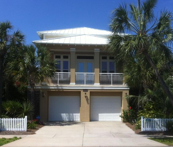 LIFE IS GOOD in this exclusive gated beachfront community on Holiday Isle. Owners and guests have access to 2 community pools and $1000 feet of beaches, jetties and the Destin Pass.  Uniquely decorated in West Indies style, this home is fully furnished with most furniture being like new. Surround sound in living room with all components remaining.  Future elevator shaft, currently being used as a closet in master bedroom, as well as an interior stairwell from main floor to garage.  Exterior features include sprinkler system, lush landscaping, freshly painted rear stucco fence, outdoor shower and removable hurricane panels front and rear windows & doors on main level.  Termite contract in place.  NEVER FLOODED. SEE YOUTUBE VIDEO 3593 WAVERLY CIRCLE