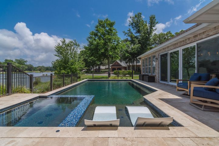 Custom HEATED and COOLED pool with over-flow spa, tanning deck