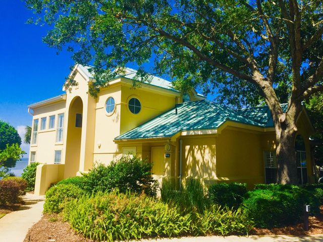 Imagine views of the Choctawhatchee Bay from your fully stocked kitchen, dining area and living room with access to a well landscaped grassy area. Perhaps you're barbecuing steaks on the patio outside the enclosed linai, taking in the panoramic bay view footsteps away. The first floor of this furnished end unit encompasses a spacious tiled living room, eat-in dining area, custom kitchen cabinets, pantry/ utility room, and an oversized Master bedroom with remodeled MBA and new flooring. The second bedroom has its own entry that can be configured as a lock-off or private room for family to come and go as they please. It provides a comfortable work-from-home office space with built-in cabinetry, 2 desk areas, and tons of storage. All bedroom closets feature ''California'' shelving. The guest bathroom with shower/tub contains lockable storage space for rental-ready convenience. An electric fire place grounds a custom-built entertainment center in the living room.   The second floor offers another oversized Master Bedroom suite featuring Tommy Bahama furnishings, his and her sinks, whirlpool, and glass-enclosed shower. A perfect spot for a comfortable reading chair or work area waits on the landing overlooking the Bay, adjacent to an ample linen closet. Or enjoy glorious sunsets on the large private patio wired with outdoor speakers.  A dedicated parking space for this townhome is just feet away from the front door.