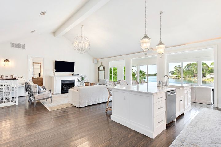 RENTAL PROJECTIONS $137k! As you enter into this Charleston inspired home, you'll be met with 180 degree views across the Choctawhatchee Bay and highly-coveted Buck Bayou. The coastal flare of the finishes and interiors in this 5 bedroom 4 full bathroom home truly shine as natural light pours into the main living areas, making it ideal for entertaining. The home is situated on a quarter acre, 75 foot waterfront lot with over 400 square feet of covered back patio overlooking the bayou and bay. A charming brick paver path guides you to a boat dock complete with a 12,000 pound lift, two boat slips, a sun deck, electric hookup, running water. and a ladder off of the swim platform.The home boasts a private gate, 6 parking space driveway, 2 car attached garage with new floorin The front of the home is beautifully landscaped with tall palms and native vegetation and the expansive backyard is enclosed with black wrought iron fencing.   Upon entering into this open-concept second floor, you're immediately welcomed by awe-inspiring Buck Bayou and Choctawachee Bay views through the large Florida room windows. The open kitchen/living dining is outfitted with contemporary Restoration Hardware light fixtures and 20' cathedral ceilings. The kitchen is equipped with impeccable stainless steel appliances, massive 10 foot island with under-bar storage, Calacatta Quartz counter tops and full backsplash, farmhouse-style porcelain sink, built-in wine fridge, and plenty of extra cabinet space. You'll enjoy Bay views from the kitchen, living room, dining area, and even the spacious master suite. The master boasts crown molding tray ceilings as well as a walk-in closet and glass French doors which open into the Florida Room. The master bathroom boasts a Carrara marble double vanity, a jetted jacuzzi tub, additional closet and custom built-in shelving.   On the main level there are two additional bedrooms - one is waterfront with captivating bayou views and another is large enough to fit two full beds and serve as an office (as seen in the photos). The two full bathrooms (both recently remodeled) showcase the amount of space and privacy that this home allows on both floors. The main floor wet bar, living, bedroom, and bathroom could easily be partitioned off for a mother in law suite or short term vacation rental. The waterfront living room leads into the dining area and full wet bar featuring a sink and refrigerator/freezer. The 500 sqft waterfront patio provides panoramic bayou views and is perfect for entertaining. Conveniently located between 30A and Destin, this home is centered in one of the most desirable locations on the Emerald Coast. You'll be minutes to the nearest beach access, Sandestin, and the renowned shopping, dining and entertainment of Grand Blvd and Silver Sands Outlets. Driftwood Park is a short walk from the home and the events at Sandestin are a short drive away.  Additional info: No HOA dues, surround sound in living room, 2 car garage has new flooring, lockout capability to rent out first floor, custom millwork, new interior and exterior paint, new irrigation system and sod, large fenced backyard perfect for dogs, children or a pool. A 1 year home warranty will be included with sale.