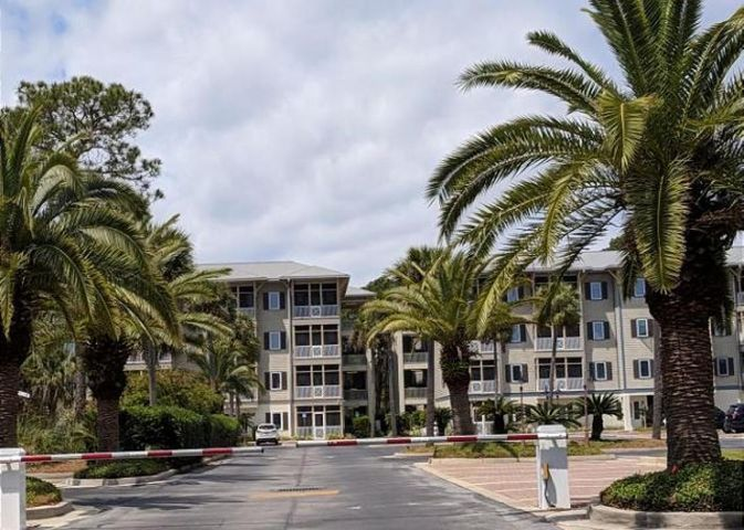 Ground floor unit in quiet gated community.  Amenities include pool, club house, lake, grills, charging station and just a short walk to the beach.  Beautifully landscaped with outdoor lighting and ample parking.  Unit has new flooring, new kitchen cabinets, and new heat pump. There is also a laundry closet and Pantry. Appliances include refrigerator, stove, microwave, garbage disposal and dishwasher. Water and basic cable furnished by condo association.