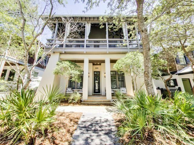 Wonderful Rosemary Beach home south of 30A with private pool, gulf views, and just a 2-minute stroll to the beautiful white sands or the entertainment of Barrett Square. The natural wood craftsmanship provides a unique and contemporary inviting space both inside and out. Perfect for families who want to make lifelong memories while capitalizing on owning in Rosemary Beach - both short term collecting rental income, and long term potential appreciation. This home has 4 bedrooms PLUS a bunkroom/game room combo and 4 full baths and can accommodate up to 14 guests. There are also 3 full parking spaces on the property, a rarity for this area of Rosemary Beach. As you approach the back side of this charming home, the outdoor area invites you in with the gorgeous pool and spa that features a complete outdoor kitchen with built-in alfresco gas grill, granite countertops, U-Line ice maker, and refrigerator. Plenty of seating options offer you space to dine, relax, and recline while taking in the infinity spa which cascades into a beautiful pool with a waterfall feature and LED lighting. You can turn off the spa jets that flow into the pool, and within hours, your spa is heated to 104 degrees! There is also a beautiful outdoor fireplace for cool evenings as you relax and listen to your favorite music. The entire house (including outside living area) has the Sonos music system throughout, so you can use your laptop or smartphone to play any of your favorite music!  As you enter through the back door from the pool area, there is a full-size washer and dryer to the left. This floor has four spacious master bedrooms that bring the beautiful coastal ambiance indoors with designer furnishings. Each feature vaulted ceilings, flat screen TVs, and ceiling fans. The first master bedroom suite on your right features a queen-sized bed with its own private bathroom - a vanity sink and full bath for soaking in. The second master bedroom has a plush king-sized bed with a spacious feel, incl