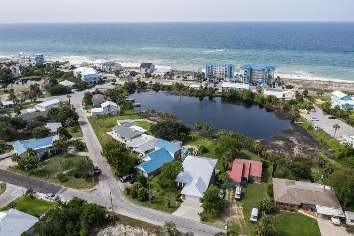 Amazing location on the West End of Panama City Beach in the sought after Laguna Beach Estates neighborhood. This spacious 3-bedroom, 2-bath home is on the lake, and just one block to the beach with beautiful sneak peak of the gulf from the second floor balcony. This home features vaulted ceilings, two car garage, breakfast bar, kitchen with office area, separate garden tub in master bath. Recent updates include freshly painted walls and brand new carpet. Short drive to Pier Park or the Coastal Dune Lakes of 30a. Call today to setup your private tour.
