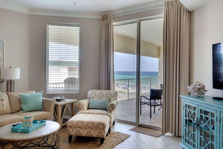 where stunning views of the Gulf of Mexico await. The master bedroom suite is elegantly decorated and features an accented shiplap wall, a lavish sitting area, balcony access and an ensuite complete with a tiled walk-in shower, soaking tub and double vanities. The spacious balcony is perfect for entertaining and relaxing all while soaking in the views of the emerald green waters of the Gulf of Mexico.  Additional upgrades to this well appointed condo include custom light fixtures, crown molding in the kitchen and living room, brand new cabinets in both bathrooms, extended kitchen countertops and 10 foot ceilings through part of the interior. Dunes of Seagrove is one of few condo complexes on 30A that offers top notch amenities including direct beach access via a private boardwalk with no steep steps, two large resort style pools that are seasonally heated, a hot tub, an exercise room, a sauna and steam room, on-site bike rentals, a grilling area, tennis courts, beachside kayak and paddle board rentals and an on-site rental management company. Unit 402B would make a great second home, or a perfect investment property. This unit is being offered fully furnished and turnkey ready.